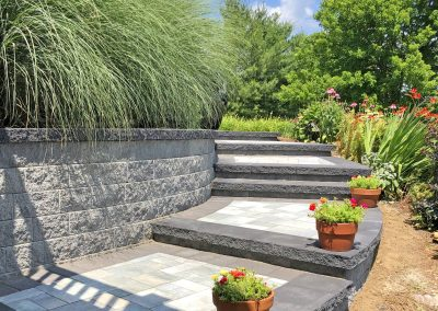 curved paver steps with plants